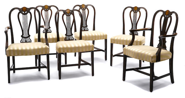 A set of six George III style inlaid mahogany dining chairs