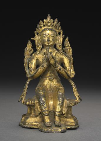 A gilt copper alloy figure of Maitreya