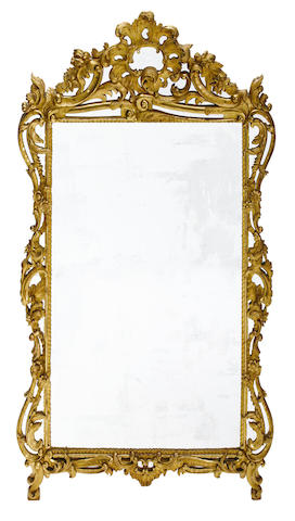 A large Continental Rococo style giltwood mirror