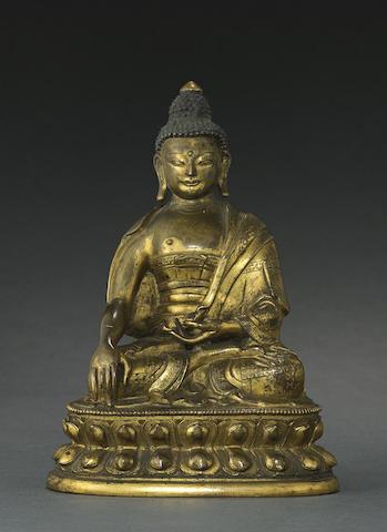 A gilt copper alloy figure of Buddha