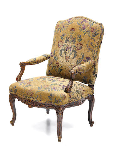 A louis XV style carved beechwood fauteuil