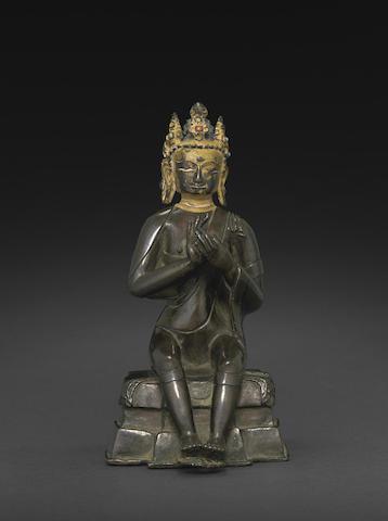 A copper alloy figure of Maitreya