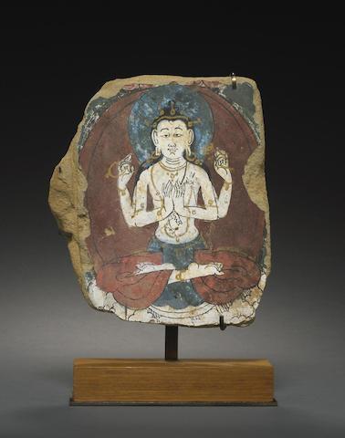A painted stucco mural fragment of Avalokitesvara Shadakshari