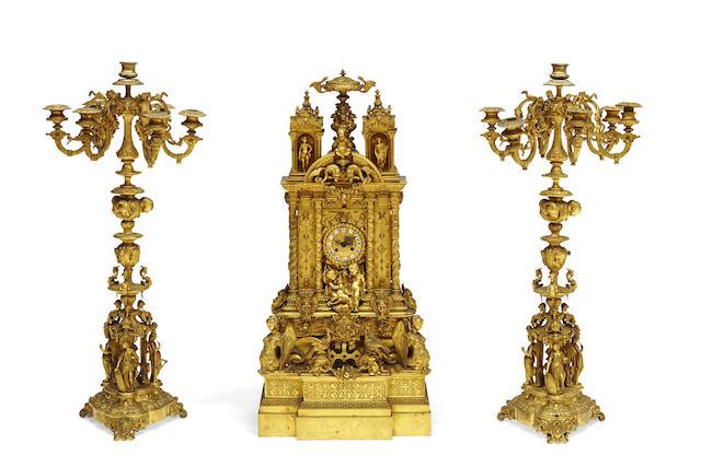 An imposing Napoleon III gilt bronze clock garniture