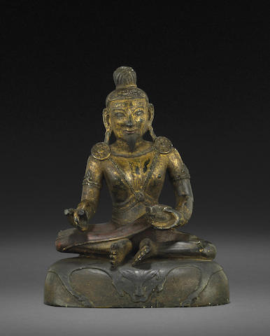 A gilt and painted stone figure of a mahasiddha