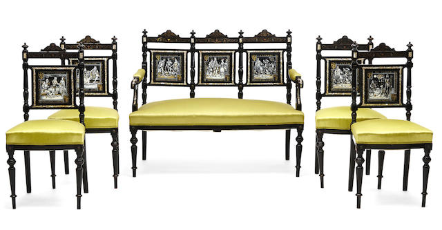 A suite of French cut brass inlaid and enamel panel inset ebonized seat furniture