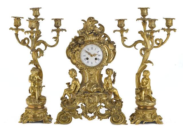 A French gilt bronze assembled three piece clock garniture