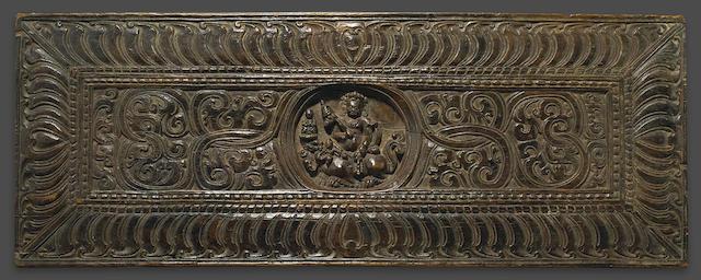 A wood manuscript cover with Vaishravana