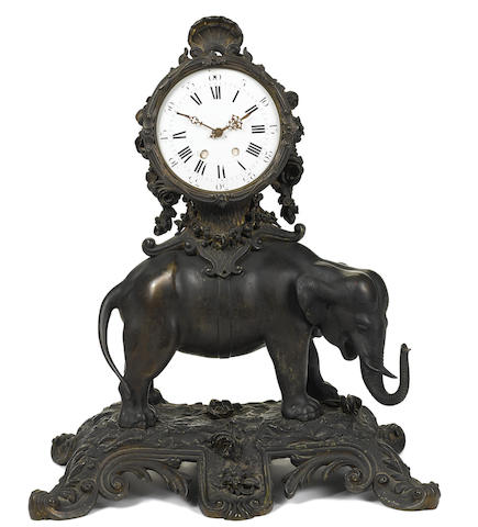 A large Continental patinated and painted bronze elephant mantel clock