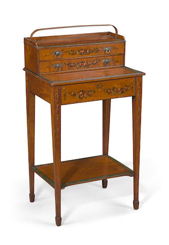 A George III paint decorated satinwood cheveret table