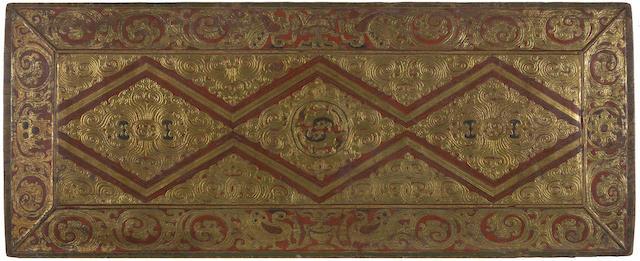 A gilt polychromed wood manuscript cover