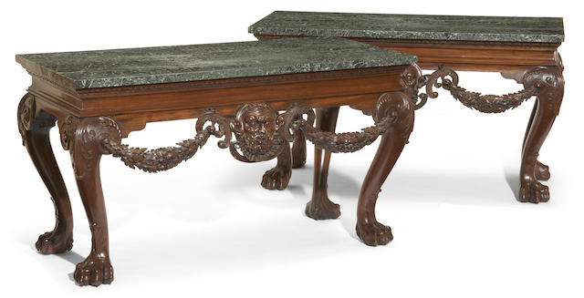 A pair of Irish George II style mahogany consoles possibly by Hicks of Dublin