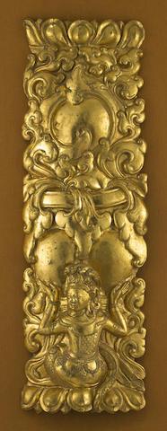 A repoussé gilt copper alloy panel