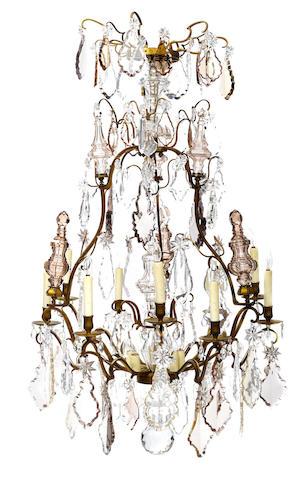 A Louis XV style gilt metal and cut glass fifteen light chandelier