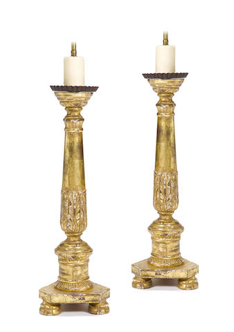 A pair of Italian Neoclassical style carved giltwood table lamps