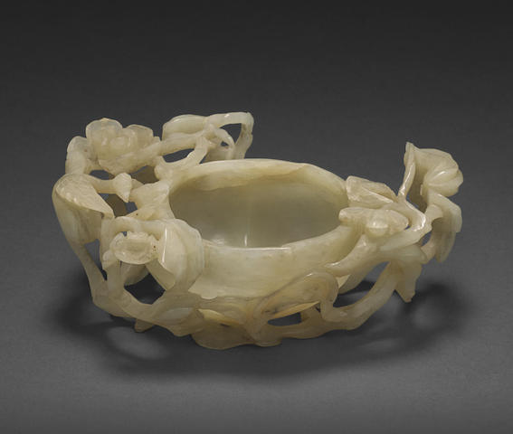 A carved jade peach form water coupe
