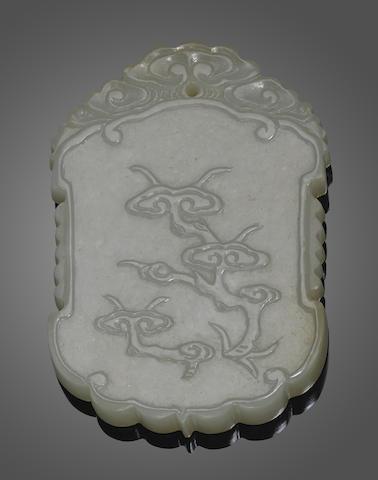 A carved rectangular jade plaque