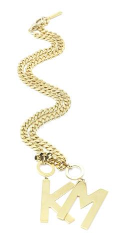Kylie Minogue: a Dolce and Gabbana K M necklace