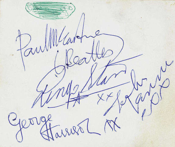 The Beatles: An autograph book signed by the Beatles and others