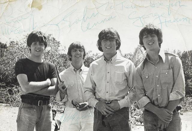 The Beatles: An autographed publicity photograph