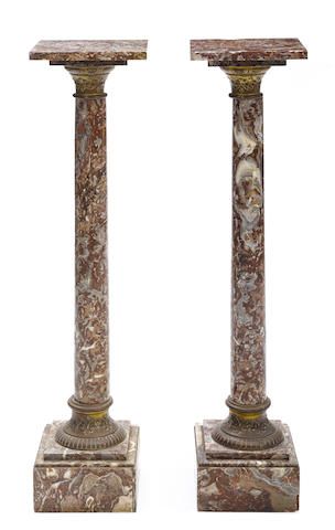 A pair of Neoclassical style gilt metal mounted marble pedestals