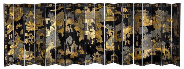 An imposing Chinese gilt heightened eighteen fold floor screen