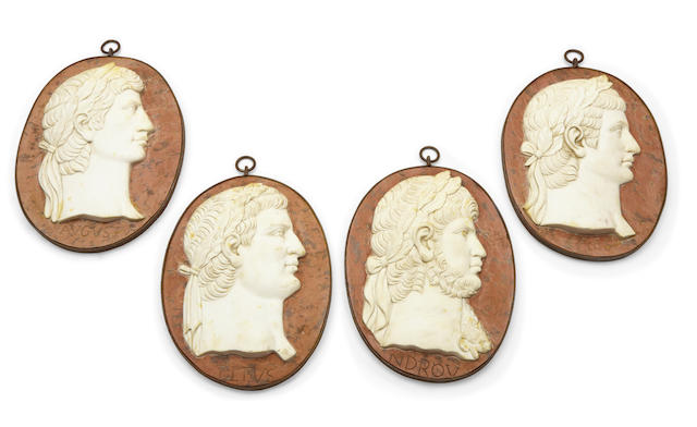 A set of four cast iron mounted carved marble relief portrait plaques