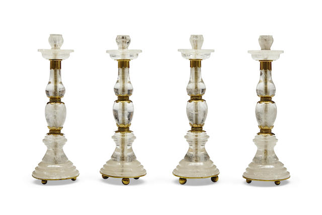 A set of four Baroque style gilt metal mounted rock crystal candlesticks