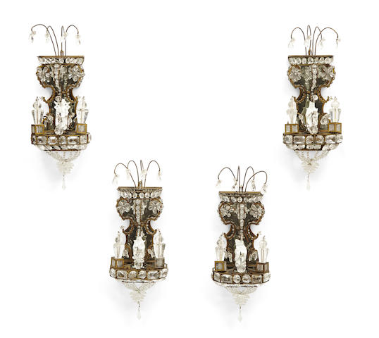A set of four French rock crystal, glass and gilt metal wall sconces