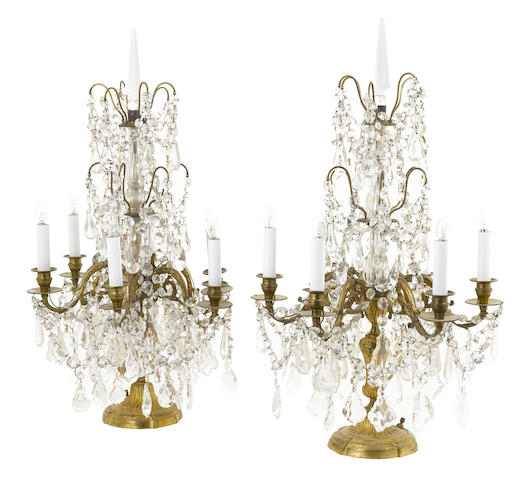 A pair of French gilt bronze, cut and molded glass six light girandoles