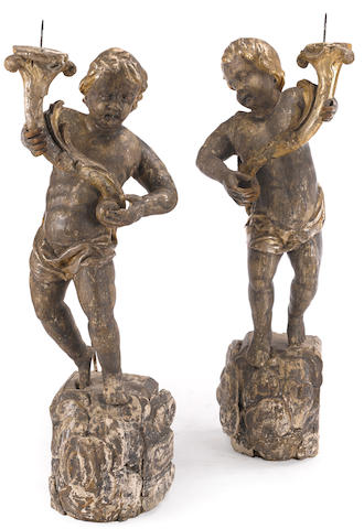 A pair of Continental Baroque silver gilt figural torchères
