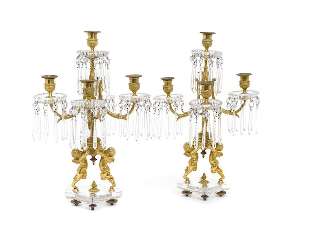 A pair of Baccarat gilt bronze and glass five light candelabra