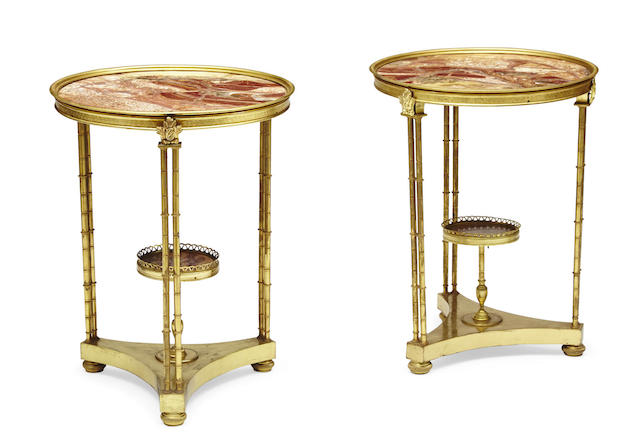 A pair of Louis XVI style gilt bronze and marble two tier guéridons