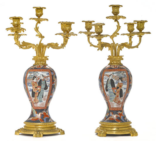 A pair of Japanese porcelain gilt bronze mounted five light candelabra