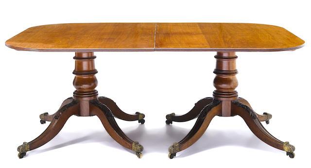 A Regency mahogany twin pedestal dining table
