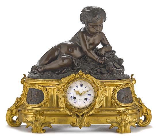 A Napoleon III gilt and patinated bronze figural mantel clock