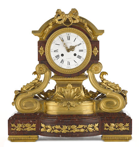 A good quality French gilt bronze mounted rouge griotte mantel clock