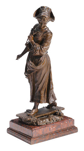 A Continental patinated bronze figure of a standing maiden