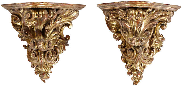 A pair of Continental Rococo style giltwood wall brackets