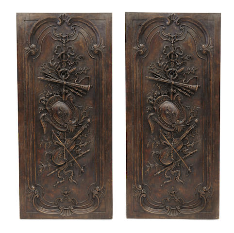 A pair of Neoclassical style carved hardwood doors