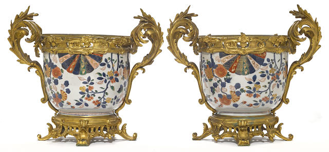 A pair of French gilt bronze mounted Chinese Imari porcelain jardinières