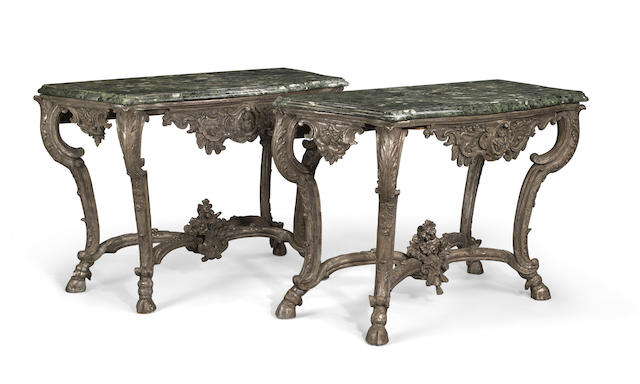 A pair of Italian Rococo carved silvered wood consoles