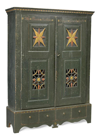 A Continental Baroque paint decorated cabinet