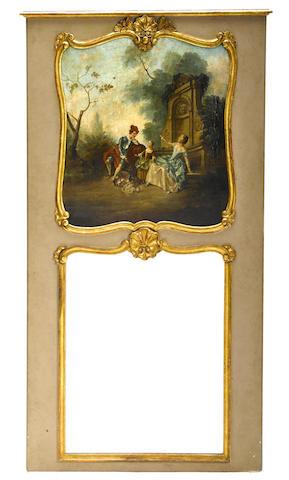 A Louis XVI style parcel gilt and paint decorated trumeau