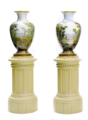 A fine and imposing pair of Baccarat enameled opaque white glass landscape vases