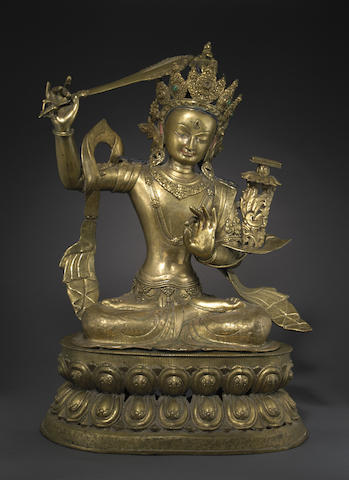A large cast gilt copper alloy figure of Manjusri