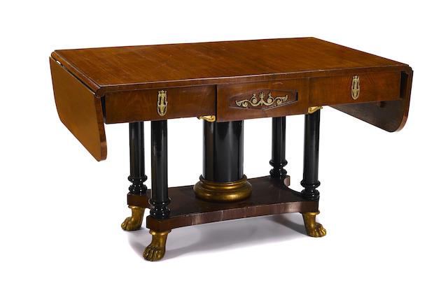 A Biedermeier parcel gilt and ebonized mahogany sofa table