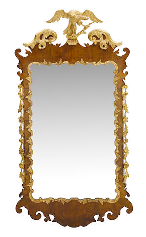 A George II parcel gilt walnut fret carved wall mirror