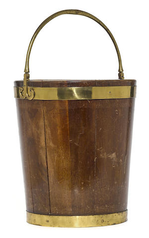A George III style brass bound mahogany bucket