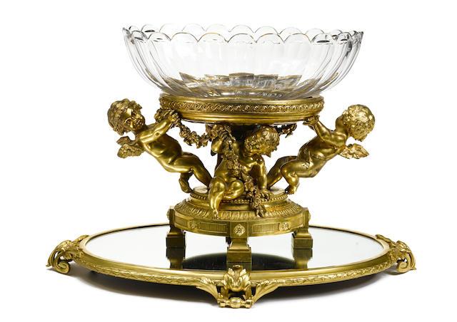 An imposing French gilt bronze centerpiece on an associated plateau